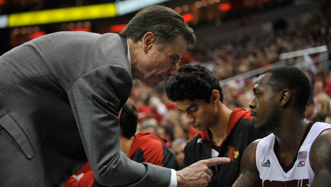 Louisville coach Rick Pitino pulled guard Chris Jones from the game early inthe second half, then talked to him on the bench.  Jones did not return to the game.  Feb. 11, 2015.
