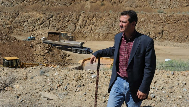 Corrado De Gasperis, president of Comstock Mining Inc., stands above his mining operations between Silver City and Gold Hill.