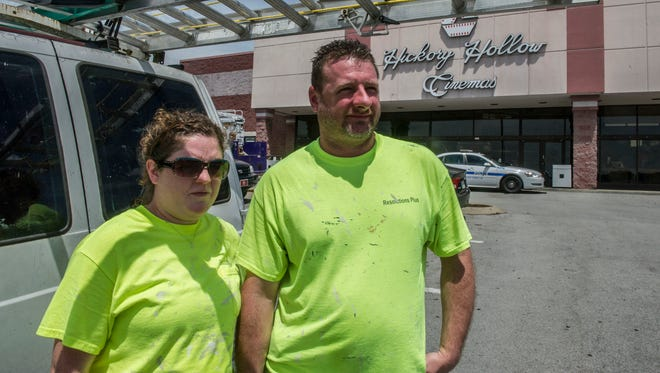 """John Cornelius and Brigett rippa repaired wall inside the theatre today. Rippa said it was """"Eerie inside the theatre""""The Carmike Hickory 8 theatre that was focus of national attention last week will re-open at 6pm on Monday Aug. 10, 2015, in Nashville in Tenn."""