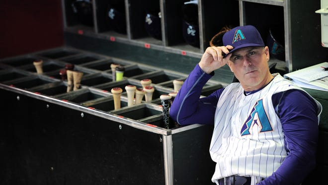 Aug 9, 2015: Arizona Diamondbacks manager Chip Hale (3) looks on from the dugout prior to facing the Cincinnati Reds at Chase Field.