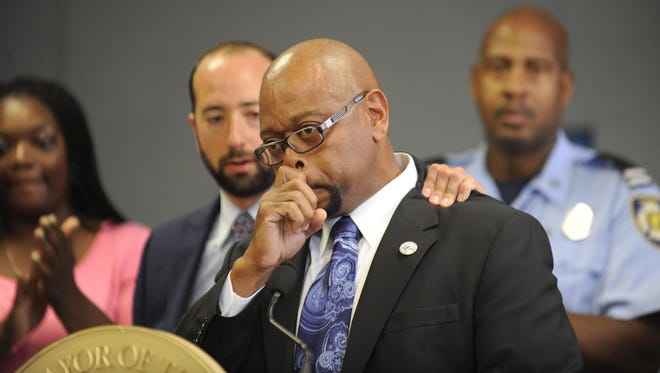 Fire Commissioner Edsel Jenkins gets choked up at a news conference at Cody High School's Medicine and Community Health Academy in Detroit.