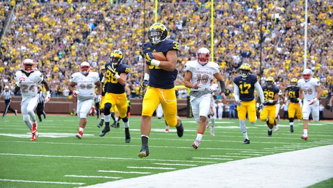 Michigan running back Ty Isaac outruns the Runnin' Rebels defense on this 76-yard touchdown run in the second quarter.