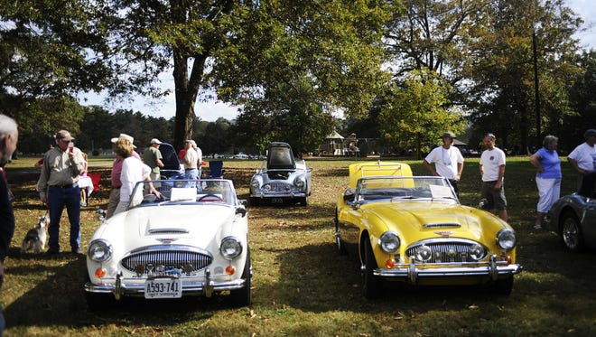 Patrons and car owners gather during the British Car Show at Ridgeview Park in Waynesboro.
