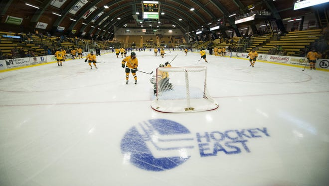 The teams warm up before the start of the men's hockey game between UMass-Lowell and Vermont at Gutterson Fieldhouse on Nov. 6, 2015.