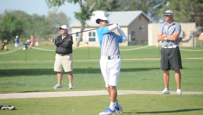Carlsbad's Angelo Cordova watches his shot fly toward the hole Tuesday at Hobbs.