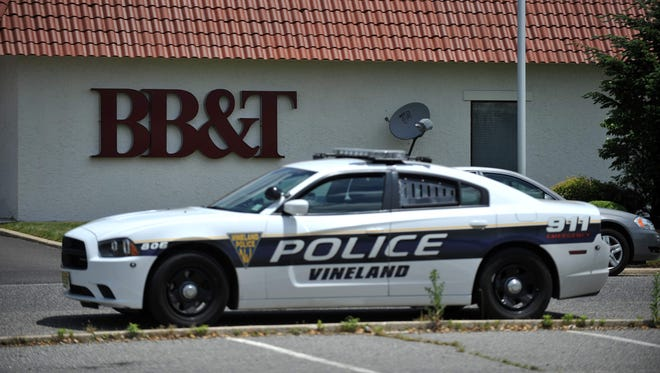 Law enforcement investigate a robbery at the South Lincoln Avenue branch of BB&T bank, Wednesday, Jun. 1 2016 in Vineland.