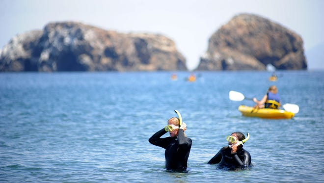 Cheryl Reed, of Boston, and her daughter Emilia Niyangoda snorkel off Scorpion Beach at Santa Cruz Island.