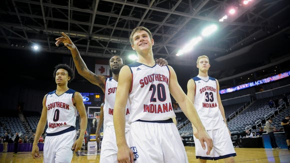 Southern Indiana guard Marcellous Washington (0) Southern Indiana guard Jeril Taylor (1) Southern Indiana guard Alex Stein (20) and Southern Indiana center Davis Carter (33) celebrate after defeating Kentucky Wesleyan  the Small College Basketball Hall of Fame Classic at the Ford Center in Evansville, Saturday, Nov. 19, 2016. Southern Indiana beat Kentucky Wesleyan 85-81.