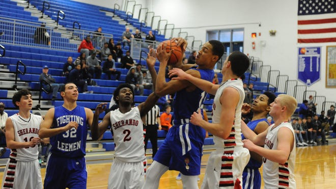 Lee High's Jarvis Vaughan runs into some traffic as he attempts a shot during Wednesday afternoon's game with Sherando.