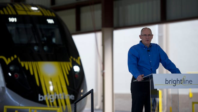 """All Aboard Florida and Brightline president Mike Reininger debuted the new """"BrightBlue"""" passenger train Jan. 11, 2017, during a media day at Workshop b, Brightine's railroad operations facility in West Palm Beach."""
