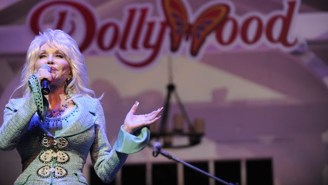 Dolly Parton speaks during a news conference on Aug. 21, 2013, in Pigeon Forge.