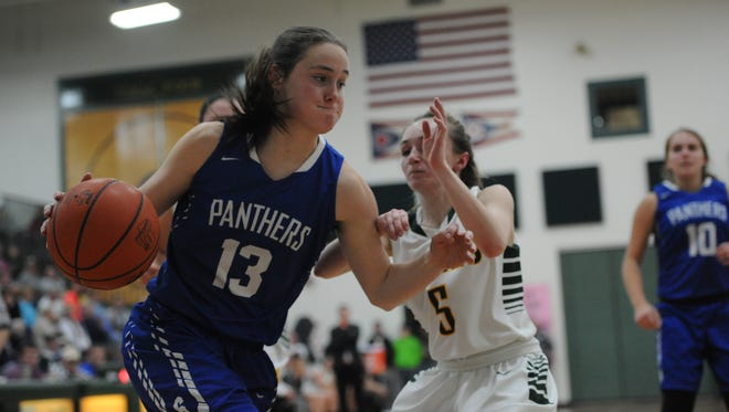 Southeastern's Ella Skeens drives past North Adams' Maddie Toole during the third quarter of Monday night's contest at North Adams High School. The Panthers defeated the Green Devils 56-48.