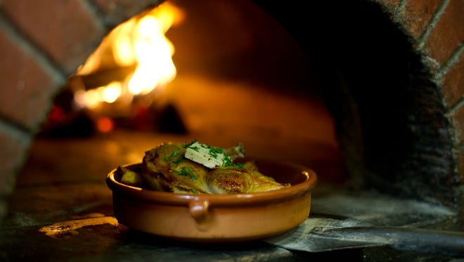 Chicken roasted in a wood-fired oven is among dishes that will be served at Hedge Row. The farm-to-table restaurant is scheduled to open in summer 2017 on Mass Ave. in Downtown Indianapolis.