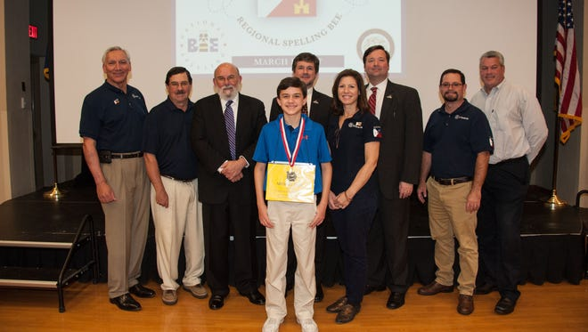 Spelling Bee Champion Michael Goss is presented as the 2017 champions by members of the Kiwanis Club of Lafayette and Kiwanis Club of Acadiana.