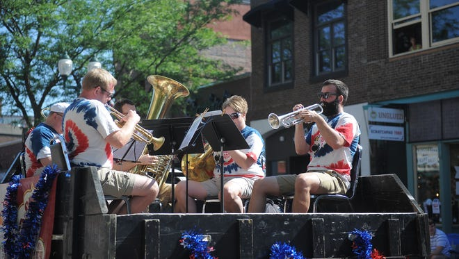 Members of the Sioux Falls Municipal Band perform during the Fourth of July parade in downtown Sioux Falls on Tuesday, July 4, 2017.