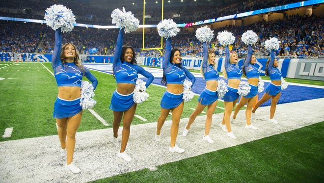 Lions cheerleaders take the field during the season opener against the Cardinals on Sunday, Sept. 10, 2017 at Ford Field.