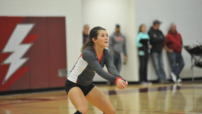 Claire Songer readies herself to dig a St. Paul serve in the district final.