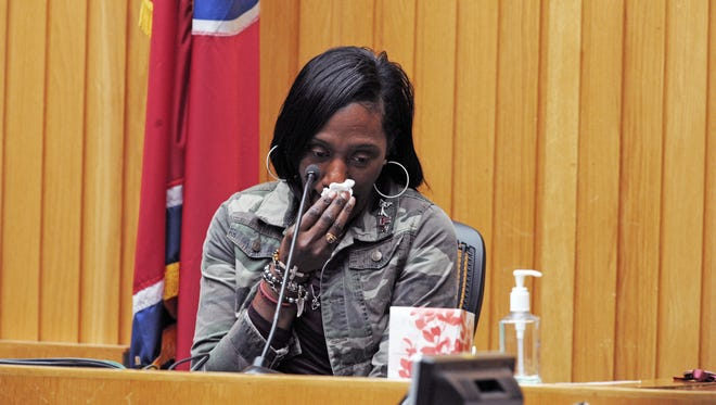 Zenobia Dobson wipes away tears as she recalls the night she learned her son Zaevion had been shot.