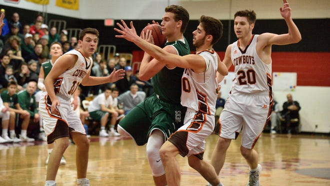 Ramapo's Jason Oppler, center, had a game-high 27 points against Dwight Morrow as Ramapo rallied to a 78-71 win at the Mel Henderson Memorial Showcase on Saturday, Jan. 20, 2018.