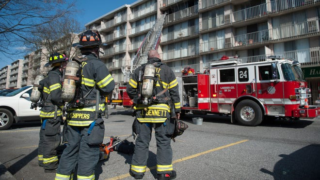 Firefighters work the scene of a three alarm fire at the Playa Del Sol apartment complex in Cherry Hill on Thursday, April 5, 2018.