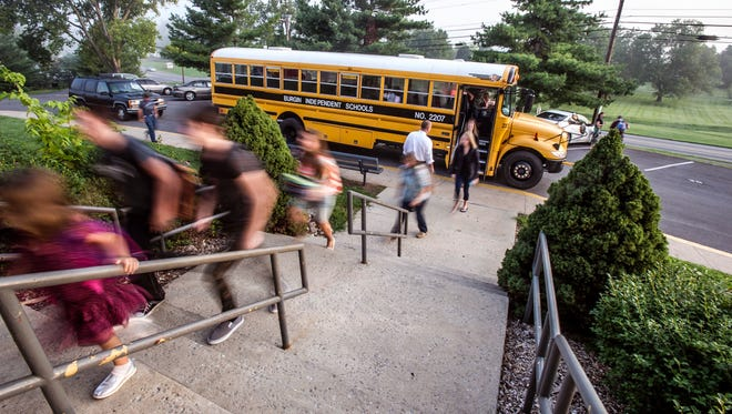 Getting off the school bus.