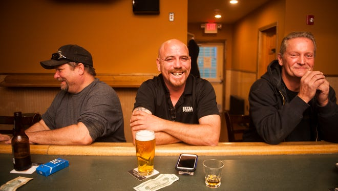 Regulars Kevin Dugan (from left) of Haddon Township, Joe Bushby of Haddon Township and Mike Varevick of Haddonfield reunite at the grand re-opening of Tom Fischer's Tavern in Haddon Township on Thursday.