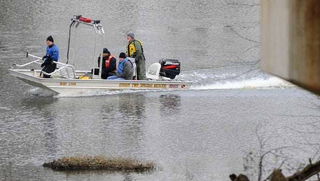 Investigators return to the boat launch after a body was found and removed from the Scioto River on Friday. A search had been ongoing for Shasta Himelrick on the Scioto River near Higby Road for several days.