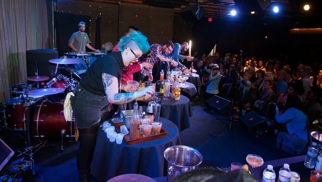 The clock is ticking during Devour Phoenix's 5th Annual Bartending Competition at Crescent Ballroom in Phoenix on Sunday, Feb. 9, 2014.