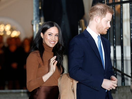 FILE - In this Tuesday, Jan. 7, 2020 file photo, Britain's Prince Harry and Meghan, Duchess of Sussex smile as they leave Canada House, in London.