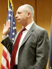 Dr. Nathan Glassman is sworn in Monday during the mental competency phase of the trial of Brian T. Flatoff in Winnebago County Circuit Court in Oshkosh.