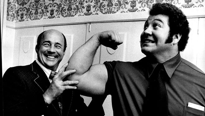 Wrestling promoter Verne Gagne, left, poses with wrestler Ken Patera in Minneapolis in this Oct. 6, 1972 photo. Gagne, one of professional wrestling's most celebrated performers and promoters died on Monday, April 27, 2015. He was 89.