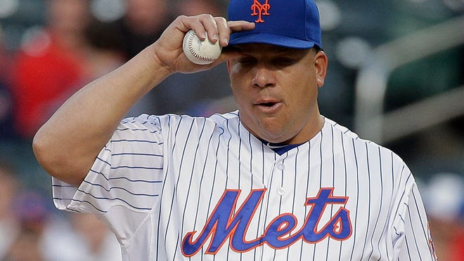 New York Mets pitcher Bartolo Colon (40) adjusts his cap after giving up a ground rule double to St. Louis Cardinals Jhonny Peralta during the first inning of a baseball game Wednesday, May 20, 2015, in New York. Kolten Wong scored on the play. (AP Photo/Julie Jacobson)