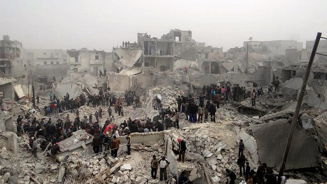 FILE - This Feb. 19, 2013, file photo, a citizen journalism image provided by Aleppo Media Center AMC, which has been authenticated based on its contents and other AP reporting, shows people searching through the debris of destroyed buildings in the aftermath of a strike by Syrian government forces, in the neighborhood of Jabal Bedro, Aleppo, Syria. The Syrian governmentâ??s decision to detain peaceful activists, in a way left the door open for more extremist elements to rise up. When the protests started in Daraa in March 2011 in response to the arrest and torture of high school students who scrawled anti-government graffiti on the school wall, security forces used brute force, beating and opening fire on largely peaceful protesters demanding reform, and later, Assad's ouster. (AP Photo/Aleppo Media Center AMC, File)