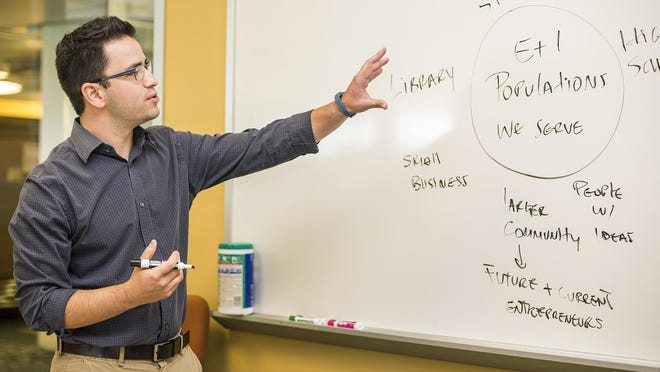 German Cadenas leads a meeting at ASU's SkySong on Thursday, August 6, 2015. Cadenas is pursuing his doctorate in psychology while working at ASU's SkySong as a strategic initiatives fellow. Cadenas was denied from ASU three times for being undocumented and has been part of many undocumented student's rights protests.