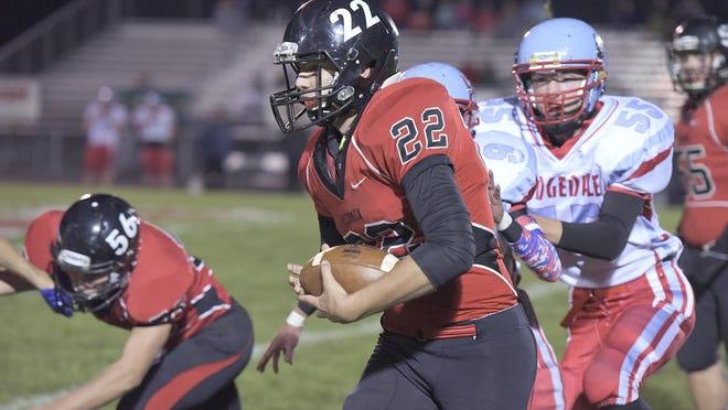 Bucyrus quarterback Gavin Lewis runs the ball.