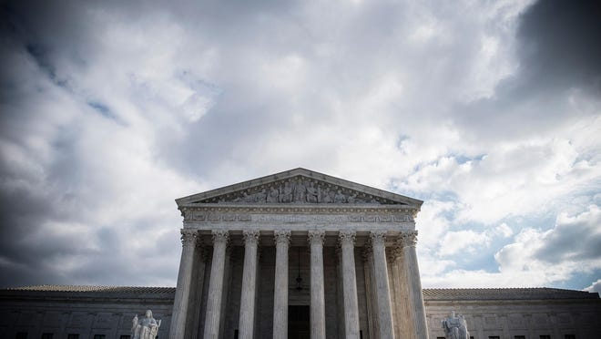 The Supreme Court has ruled that the Defense Department can enforce President Donald Trump's policy banning transgender people from serving in the military. (Eric Baradat/AFP/Getty Images/TNS)
