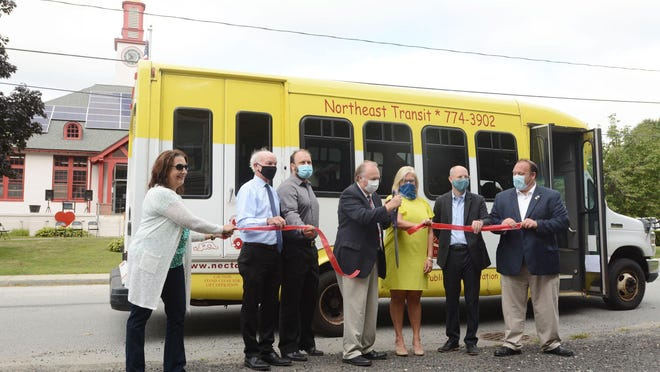 Kevin Cunningham, center, Plainfield first selectman, cuts a ceremonial ribbon with other officials Tuesday marking new bus route with Northeast Transit and SEAT to Lisbon Landing and Norwich. See videos and more photos at NorwichBulletin.com
