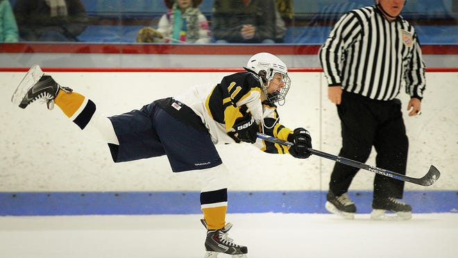 Hockey has been put on pause for two weeks after 30 clusters across the state have been traced back to games, tournaments and practices. In 2018, NDA's Jillian Lyons takes a slapshot as Notre Dame Academy hosts Needham in high school girls hockey.