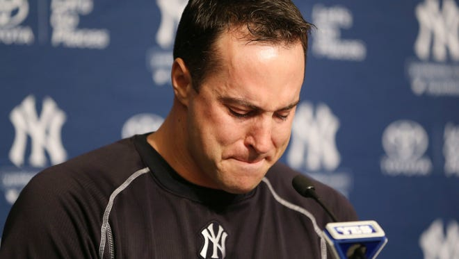 New York Yankees baseball player Mark Teixeira becomes emotional while talking to reporters at a press conference before a game against the Cleveland Indians at Yankee Stadium in New York, Friday, Aug. 5, 2016. Teixeira announced his plans to retire at the end of the season.