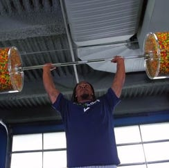 Marshawn Lynch gets ready for NFL season by working out... with Skittles