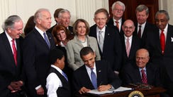 President Barack Obama signs the Affordable Care Act