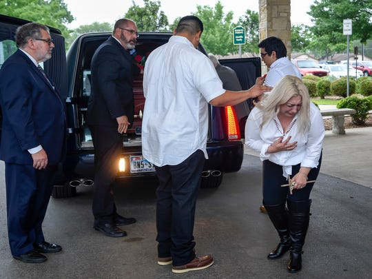 Tricia Ann Perez Sr. reacts as the body of her son Joe Jr. is put into the hearseon the way to the crematory following the funeral service at the St. Anthony's Marie de Claret Church in Kyle, Texas., Tuesday, May 1, 2018.