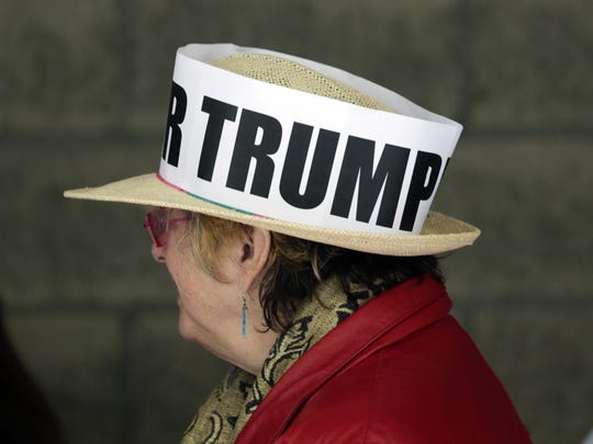 A supporter of Republican presidential candidate Donald Trump waits in line outside the Times Union Center before a rally in Albany, N.Y., on Monday.