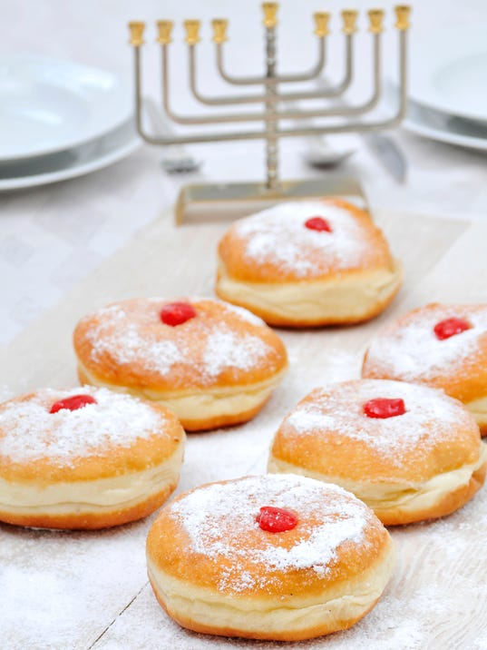 Hanukah doughnuts, sufganiya and menorah