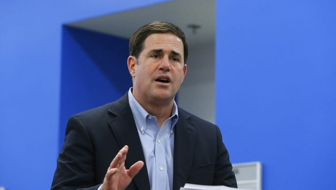 Gov. Doug Ducey speaks before he signs HB2591 Wednesday, April 15, 2015 at  TechShop in the ASU Chandler Innovation Center in Chandler, Ariz.  The bill is bill designed to broaden the way crowd-sourcing can be used to help fund start-up businesses
