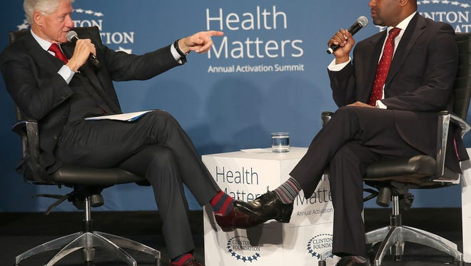 President Bill Clinton speaks with Dr. Reginald J. Eadie, Chief Executive Officer, Detroit Medical Center at a panel discussion during the Health Matters Activation Summit in Indian Wells, January 25, 2016.