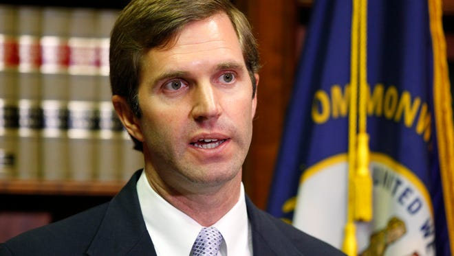 Attorney General Andy Beshear addresses the media.