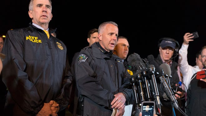 ATF Agent in Charge Fred Milanowski, left, and Interim Austin Police Chief Brian Manley, speak to the media as law enforcement investigates the scene where a bombing suspect blew himself up after being confronted by police in Round Rock, Texas, on Wednesday.