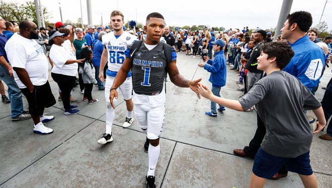 University of Memphis players Tony Pollard (right) and Joey Magnifico (left) greet fans during Tiger Walk before the teams spring football game at Liberty Bowl Memorial Stadium.