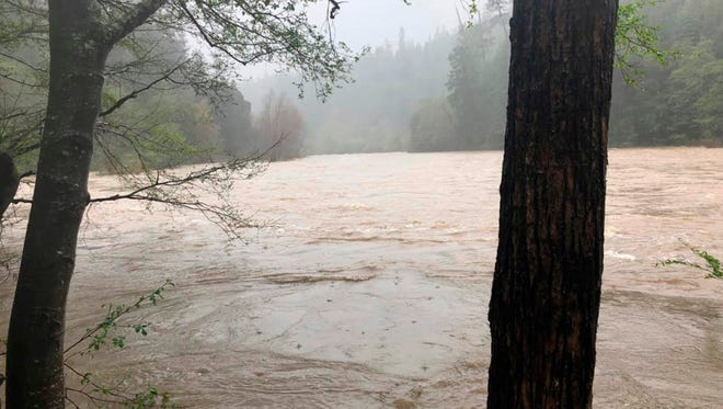 This photo released April 12, 2018, by The Mendocino County Sheriff's Office shows the Eel River in Northern California. Authorities searching for a family whose SUV plunged into a rain-swollen Northern California river found the vehicle and the body of a man and a girl inside it.